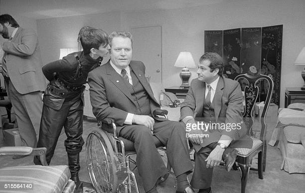 Washington: Althea Flynt whispers to her publisher husband, Larry Flynt in their hotel room after court. Flynt pleaded not guilty to charges of...