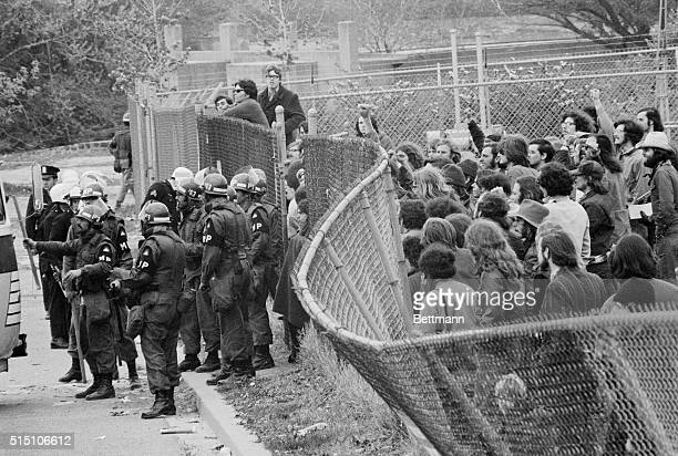 Antiwar Demonstrators try to push down a fence behind which they were corralled on a practice field alongside RFK Stadium 5/3 More than 5000 were...