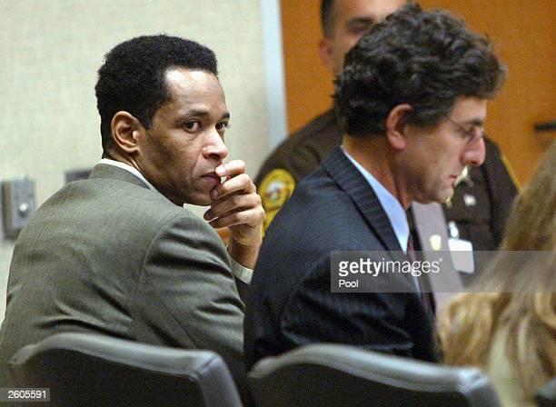 Washington area sniper suspect John Allen Muhammad listens to court proceeding with Jonathan Shapiro during his trial at the Virginia Beach Circuit...
