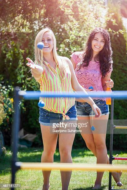 USA, Washington, Bellingham, Portrait of young women throwing balls