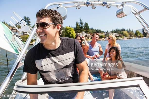 USA, Washington, Bellingham, Young people enjoying speedboat ride