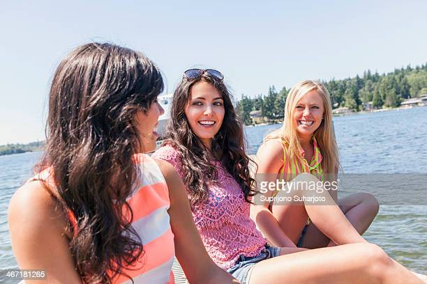 USA, Washington, Bellingham, Young women hanging out by lake