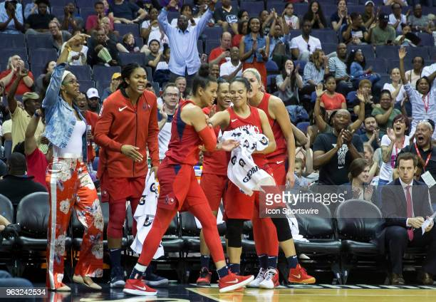 Washington bench celebrate a go ahead three pointer in the first half during a WNBA game between the Washington Mystics and the Minnesota Lynx on May...