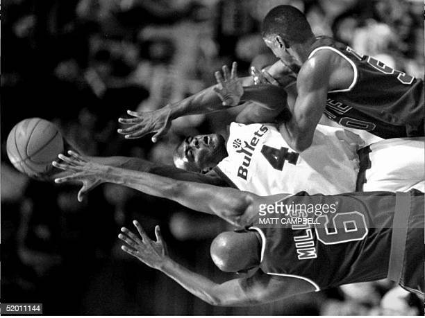 Washington Bullets' Chris Webber tries to get rid of the ball as he is trapped in a corner by the Detroit Pistons' Terry Mills and Otis Thorpe during...