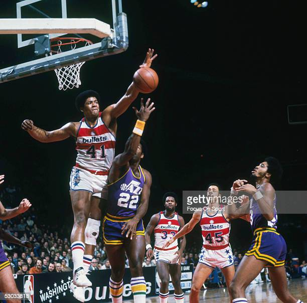 Washington Bullets' Wes Unseld jumps and blocks a shot by a Utah Jazz player during a game at Capital Centre circa the 1970's in Washington DC NOTE...