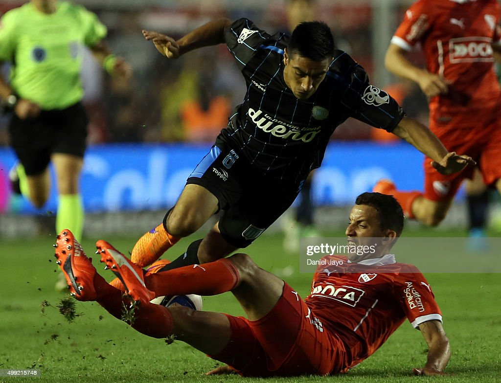 Washington Camacho of Racing Club (L) is tackled by Jorge Ortiz of Independiente during a first leg match between Independiente and Racing Club as part of Pre Copa Libertadores Playoff at Libertadores de America Stadium on November 29, 2015 in Avellaneda, Argentina.