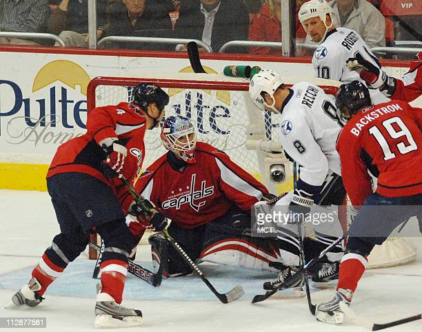 Washington Capital goalie Brent Johnson makes a save on a scoring attempt by the Tampa Bay Lightning's Mark Recchi during the third period at the...
