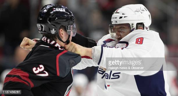 Washington Capital's Alex Ovechkin fights with Carolina Hurricanes' Andrei Svechnikov during the first period of their first round Stanley Cup game...