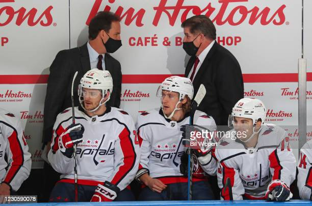 Washington Capitals assistant coach Scott Arniel talks to Head Coach Peter Laviolette during an NHL game against the Buffalo Sabres on January 14,...