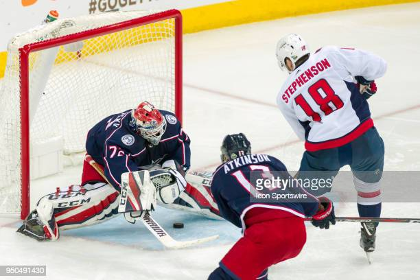 Washington Capitals center Chandler Stephenson attempts a shot and sneaks it between the legs of Columbus Blue Jackets goaltender Sergei Bobrovsky to...