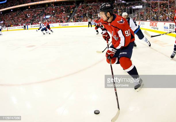 Washington Capitals center Evgeny Kuznetsov brings the puck up ice in the first period against the Winnipeg Jets on March 10 at the Capital One Arena...