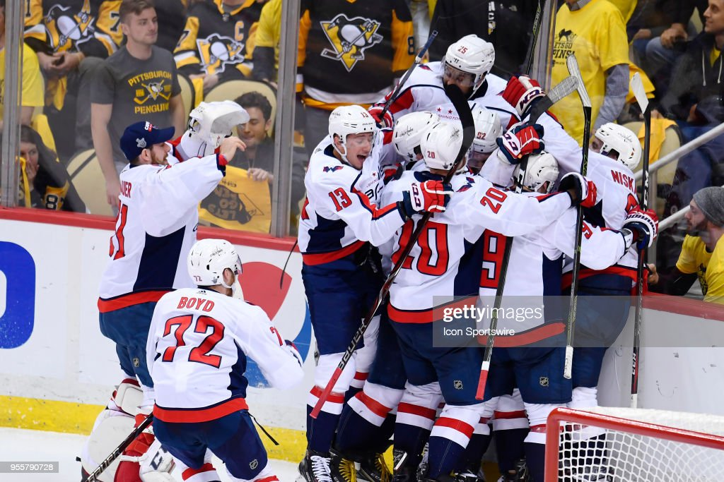 Washington Capitals Center Evgeny Kuznetsov (92) is mobbed by teammates after scoring the game winning goal during the overtime period. The Washington Capitals went on win 2-1 in the overtime period against the Pittsburgh Penguins in Game Six of the Eastern Conference Second Round during the 2018 NHL Stanley Cup Playoffs on May 7, 2018, at PPG Paints Arena in Pittsburgh, PA. The Capitals won the series 4-2 and advance to the Conference Finals.