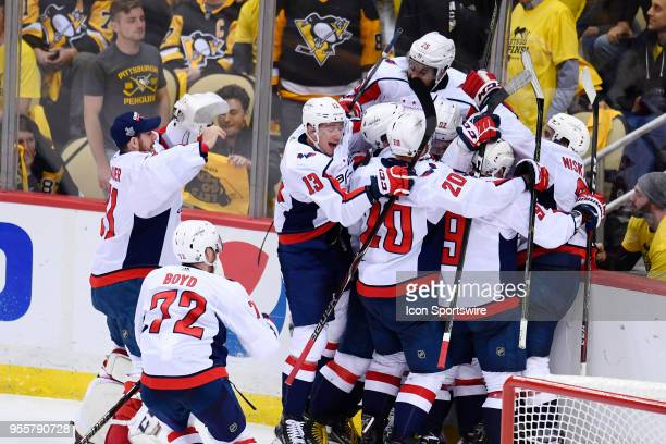 Washington Capitals Center Evgeny Kuznetsov is mobbed by teammates after scoring the game winning goal during the overtime period The Washington...