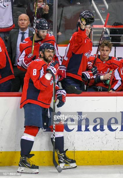 Washington Capitals center Evgeny Kuznetsov pretends to throw a helmet on the ice after left wing Alex Ovechkin scored a third period hat trick...