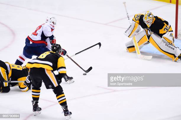 Washington Capitals Center Evgeny Kuznetsov scores the game winning goal past Pittsburgh Penguins goaltender Matt Murray during the overtime period...