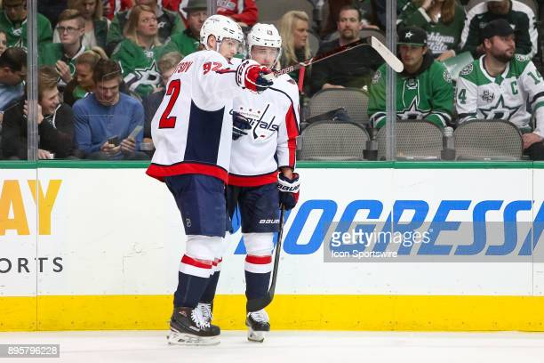 Washington Capitals center Evgeny Kuznetsov talks with left wing Jakub Vrana prior to a faceoff during the hockey game between the Washington...