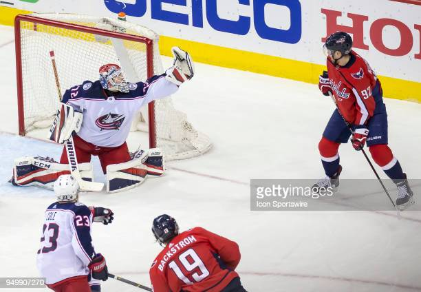 Washington Capitals center Evgeny Kuznetsov watches as Columbus Blue Jackets goaltender Sergei Bobrovsky snatches up the puck during the first round...