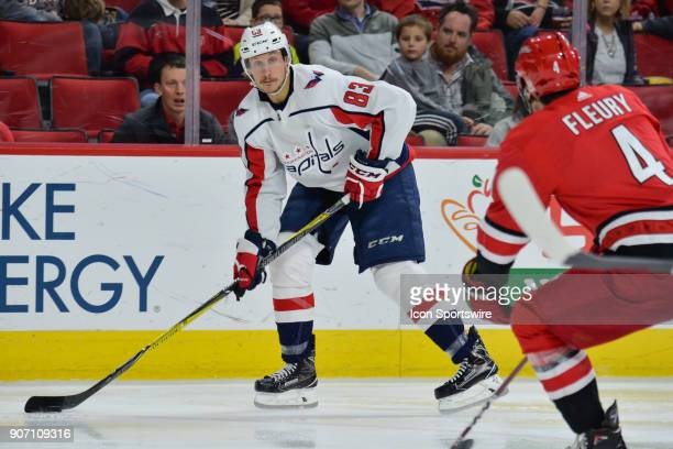Washington Capitals Center Jay Beagle looks to pass the puck during a game between the Washington Capitals and the Carolina Hurricanes at the PNC...