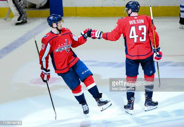 Washington Capitals center Lars Eller is congratulated by right wing Tom Wilson after his third period empty net goal against the Winnipeg Jets on...