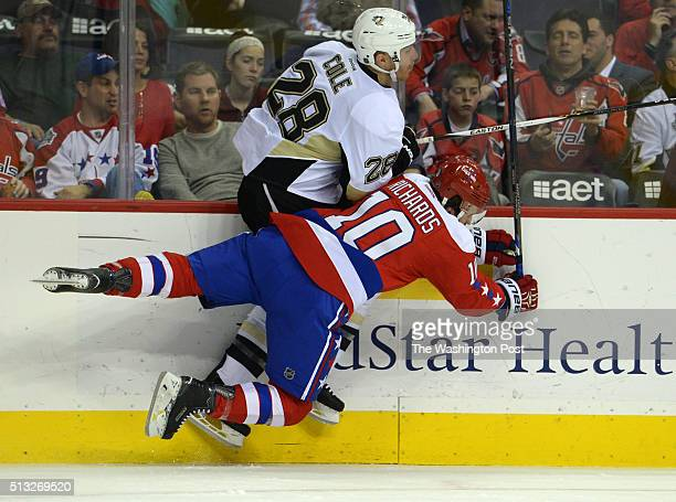 Washington Capitals center Mike Richards and Pittsburgh Penguins defenseman Ian Cole collide in the first period at the Verizon Center March 01 2016...