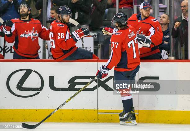 Washington Capitals center Nic Dowd and goaltender Pheonix Copley congratulate right wing TJ Oshie following his second period goal against the...