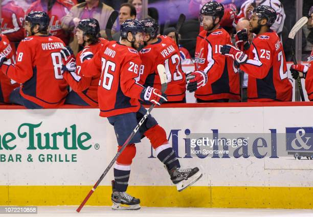 Washington Capitals center Nic Dowd is congratulated by the bench after a goal against the Detroit Red Wings on December 11 at the Capital One Arena...