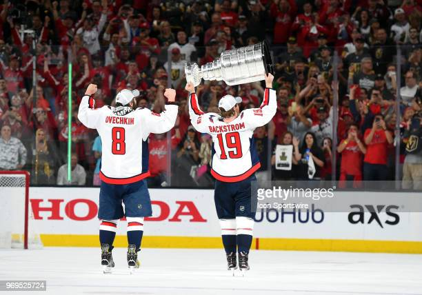 Washington Capitals Center Nicklas Backstrom hoists the Stanley Cup with Washington Capitals Left Wing Alex Ovechkin to celebrate defeating the Las...