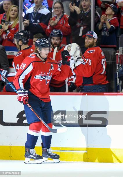 Washington Capitals center Nicklas Backstrom is congratulated by goaltender Braden Holtby after his first period goal against the Winnipeg Jets on...