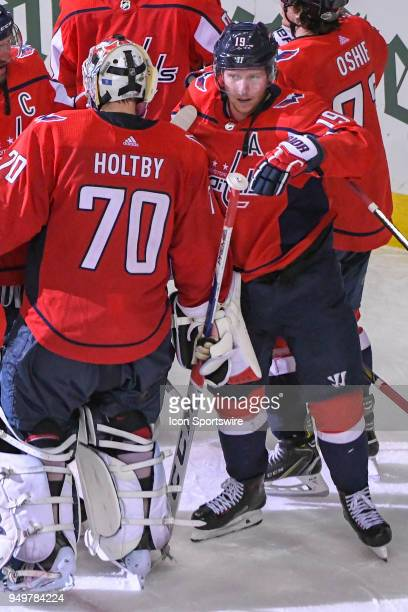 Washington Capitals center Nicklas Backstrom is congratulated by goaltender Braden Holtby after scoring the game winning goal in overtime against the...