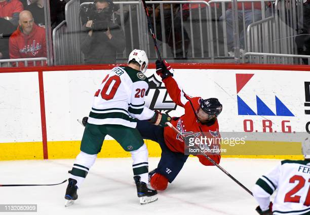Washington Capitals center Nicklas Backstrom is hit by Minnesota Wild defenseman Ryan Suter in the third period on March 22 at the Capital One Arena...