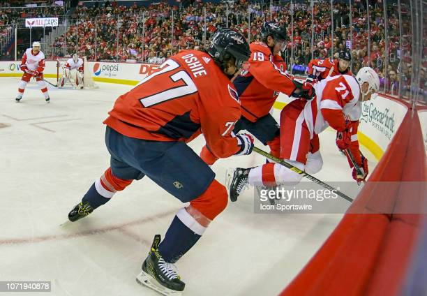 Washington Capitals center Nicklas Backstrom pushes Detroit Red Wings center Dylan Larkin into the boards in the second period on December 11 at the...