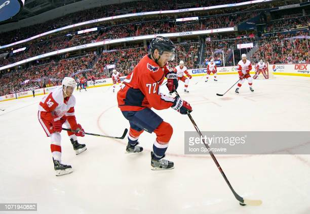 Washington Capitals center Travis Boyd skates against Detroit Red Wings right wing Gustav Nyquist in the second period on December 11 at the Capital...