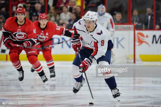 Washington Capitals Defenceman Dmitry Orlov brings the puck up ice during a game between the Washington Capitals and the Carolina Hurricanes at the...