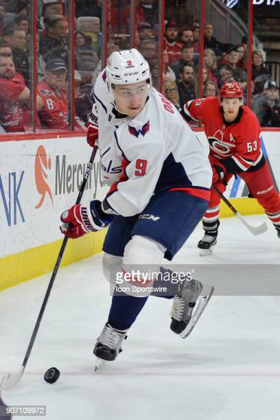 Washington Capitals Defenceman Dmitry Orlov plays a puck along the boards during a game between the Washington Capitals and the Carolina Hurricanes...