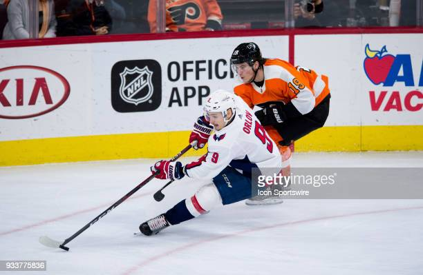 Washington Capitals Defenceman Dmitry Orlov skates toward the net defended by Philadelphia Flyers Center Nolan Patrick in the third period during the...