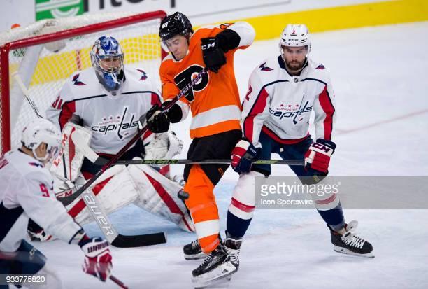 Washington Capitals Defenceman Matt Niskanen defends Philadelphia Flyers Winger Jordan Weal as he deflects a shot in the third period during the game...