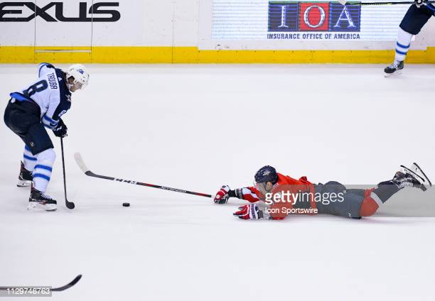 Washington Capitals defenseman Dmitry Orlov goes to the ice in the third period against Winnipeg Jets defenseman Jacob Trouba on March 10 at the...