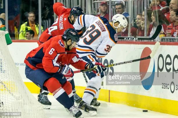 Washington Capitals defenseman John Carlson and defenseman Michal Kempny battle Edmonton Oilers right wing Alex Chiasson for the puck along the...