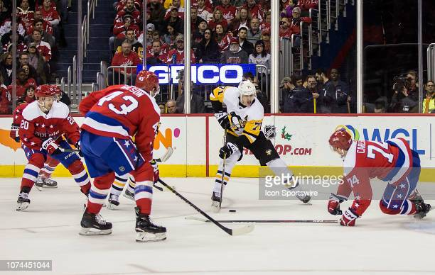 Washington Capitals defenseman John Carlson and right wing Tom Wilson defend against Pittsburgh Penguins center Evgeni Malkin during a NHL game...