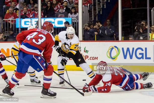 Washington Capitals defenseman John Carlson goes down to stop a shot by Pittsburgh Penguins center Evgeni Malkin during a NHL game between the...