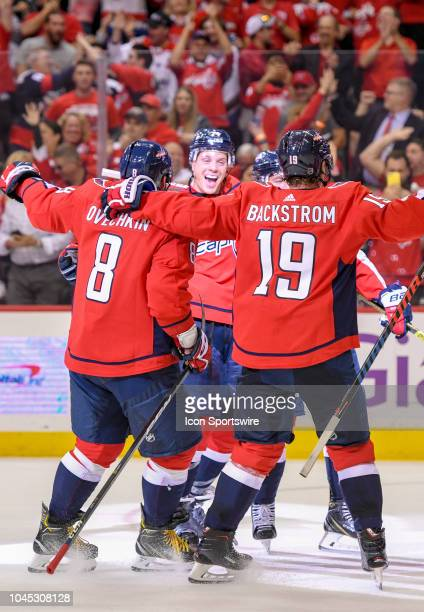 Washington Capitals defenseman John Carlson is congratulated by left wing Alex Ovechkin and center Nicklas Backstrom after his second period power...