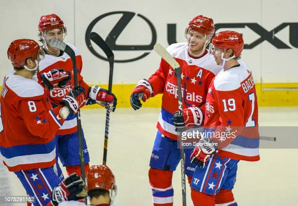Washington Capitals defenseman John Carlson is congratulated byleft wing Alex Ovechkin right wing TJ Oshie and center Nicklas Backstrom after scoring...