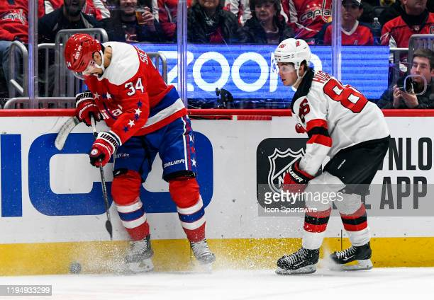 Washington Capitals defenseman Jonas Siegenthaler against New Jersey Devils center Jack Hughes on January 16, 2020 at the Capital One Arena in...