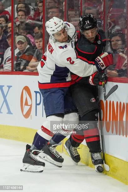 Washington Capitals defenseman Matt Niskanen checks Carolina Hurricanes right wing Justin Williams into the boards during a game between the Carolina...