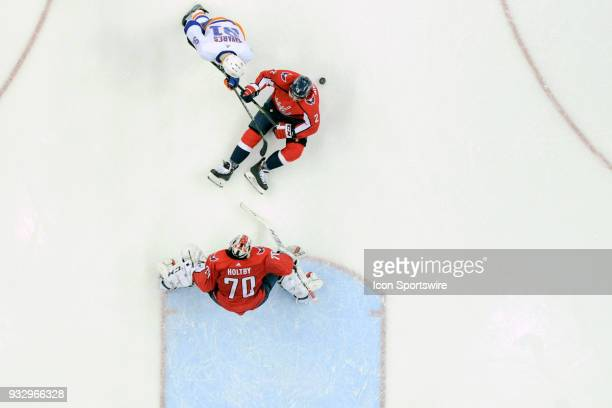 Washington Capitals defenseman Matt Niskanen goes to the ice to block the shot of New York Islanders center John Tavares in front of goaltender...