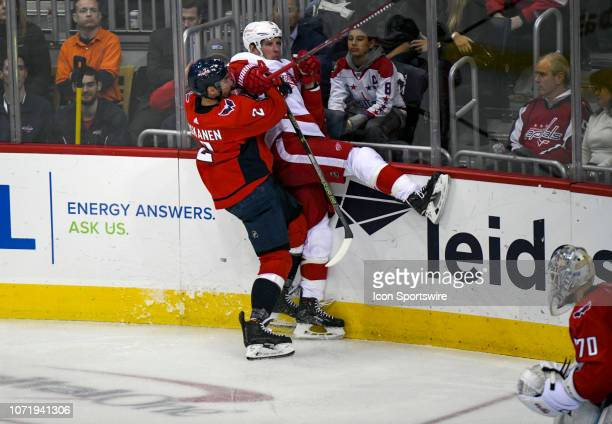 Washington Capitals defenseman Matt Niskanen hits Detroit Red Wings left wing Justin Abdelkader in the third period on December 11 at the Capital One...