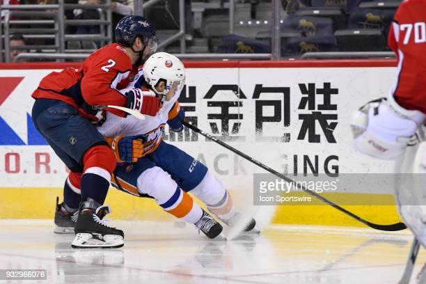 Washington Capitals defenseman Matt Niskanen hits New York Islanders center Casey Cizikas in the second period on March 16 at the Capital One Arena...