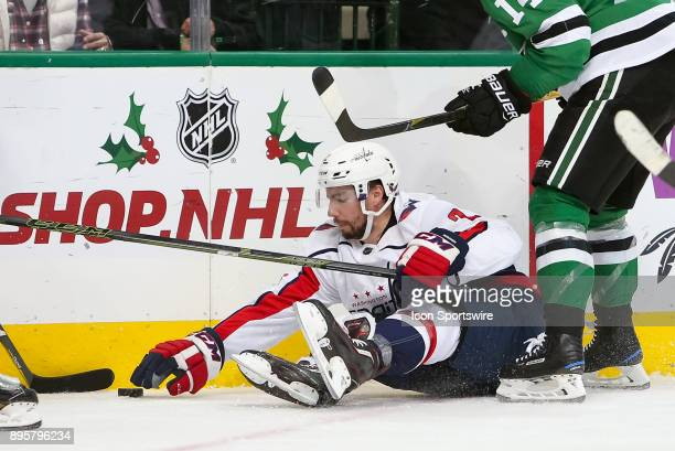 Washington Capitals defenseman Matt Niskanen reaches for a loose puck while down on the ice during the hockey game between the Washington Capitals...
