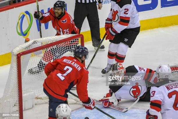 Washington Capitals defenseman Matt Niskanen scores in the third period against the New Jersey Devils goaltender Cory Schneider on December 30 at the...