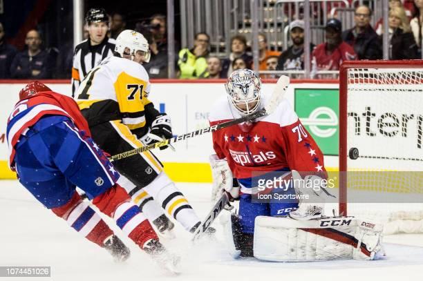 Washington Capitals defenseman Michal Kempny checks Pittsburgh Penguins center Evgeni Malkin as he shoots on goal during a NHL game between the...